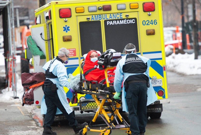A patient is transported from Verdun hospital Tuesday, January 12, 2021  in Montreal.