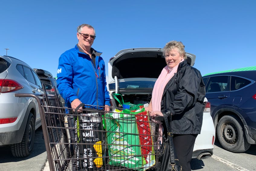 Lynda and Jerry Birrett stop to talk about the Covid-19 scare and do some shopping. Experts say being prepared doesn't hurt but there's no need to hoard. - Nebal Snan