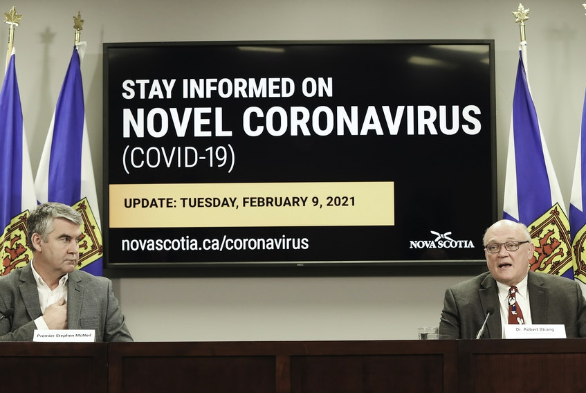Premier Stephen McNeil and Dr. Robert Strang, Nova Scotia's chief medical officer of health, speak at a COVID-19 news briefing on Tuesday, Feb. 9, 2021.