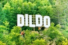 A Hollywood-like sign can be seen over the town of Dildo, Newfoundland in Canada in this undated handout photo provided August 19, 2019. After a Hollywood-like sign went up over Dildo, N.L., thanks to a segment on Jimmy Kimmel Live, town officials are asking people to stop climbing through private property to take photos with it, warning the sign may have to come down.
