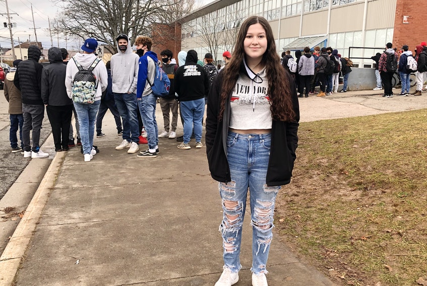 Chloe Feltham, above, helped organize an impromptu protest that started outside Sydney Academy Thursday during lunch hour. The student's were protesting a school dress code which Feltham believes unnecessarily sexualized parts of female bodies. NICOLE SULLIVAN/CAPE BRETON POST