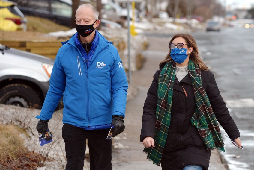 Progressive Conservative Leader Ches Crosbie goes door to door on Canada Drive Tuesday afternoon with St. John's West candidate Kristina Ennis. Keith Gosse/The Telegram