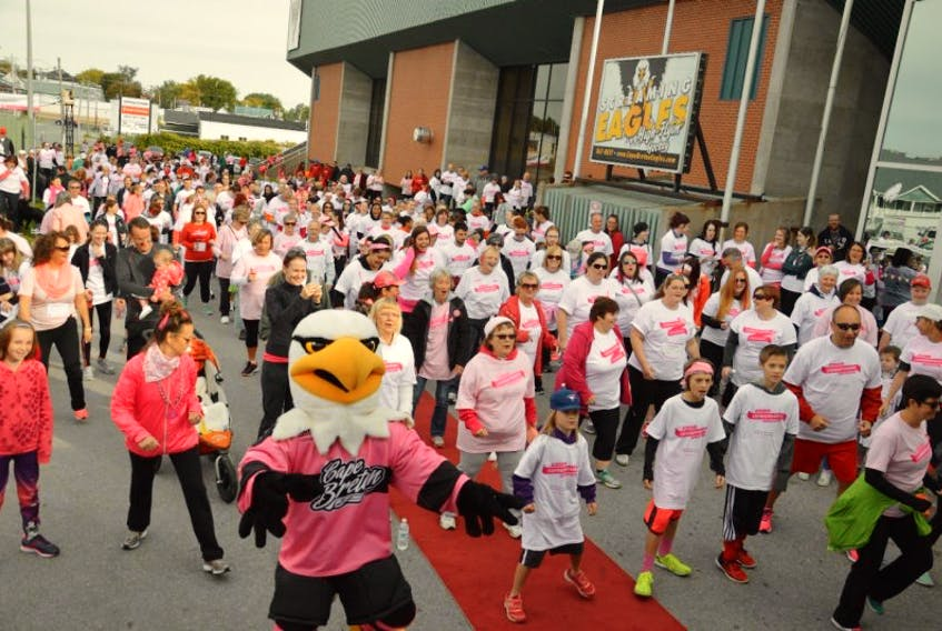 <p>Approximately 440 people took part in the Canadian Breast Cancer Foundation's CIBC Run for the Cure in Sydney, Sunday morning. Prior to the start of the run, participants warmed up outside of Centre 200.</p>