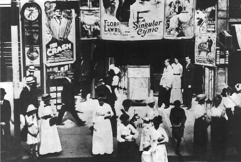 Crowds stand in front of a theatre in Toronto, ca., 1914.