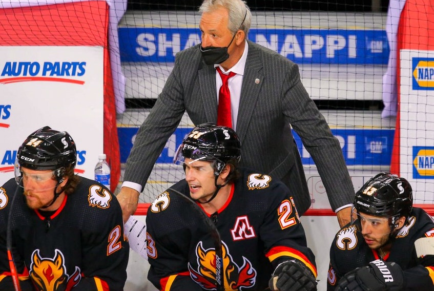 Calgary Flames head coach Darryl Sutter on the bench during a game against the Montreal Canadiens during NHL hockey in Calgary on Thursday March 11, 2021.