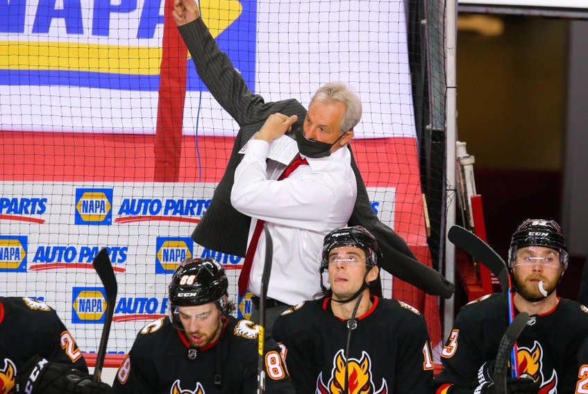 Calgary Flames head coach Darryl Sutter gets ready for the second period against the Montreal Canadiens in Calgary on March 11, 2021.