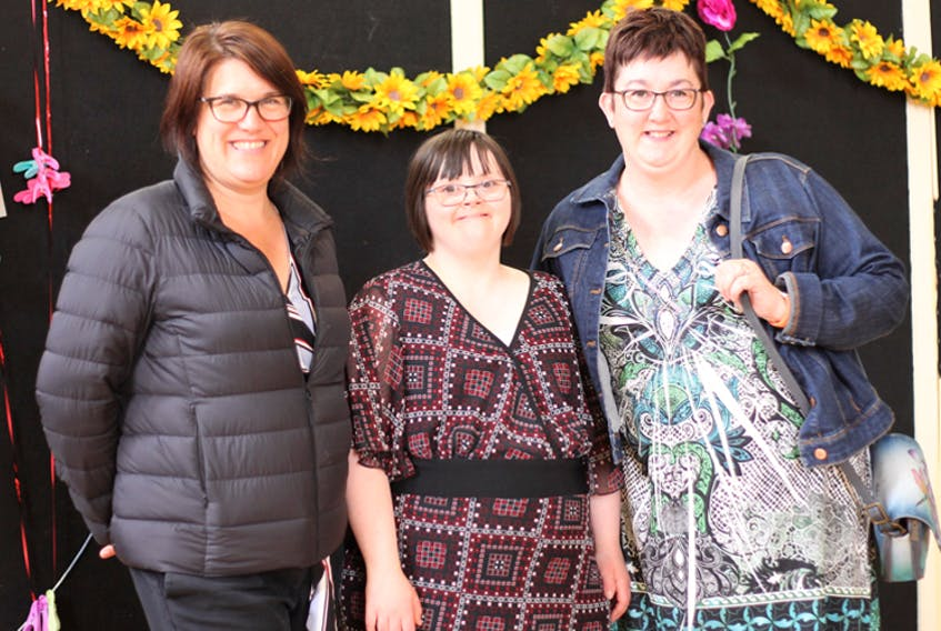 Alice Evans, executive director of The Club Inclusion, with member Katie McKay and her mom, Lynn McKay. The Club Inclusion offers social, cultural and recreation programs for youth 12 and up and adults with diverse abilities and needs.
