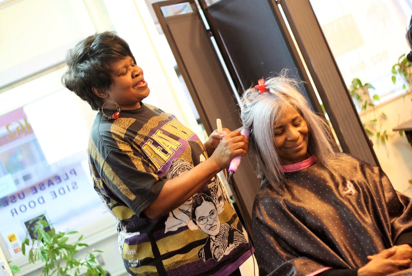 For more than 30 years, Samantha Dixon Slawter has been styling hair in the community and creating friendships along the way. Here, she styles Martha Grant's hair.