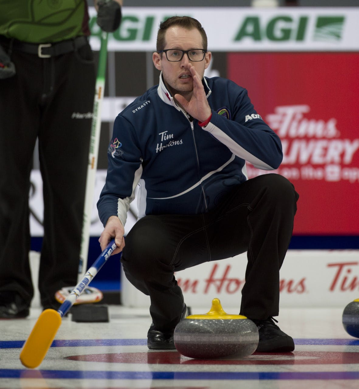 Ontario's Scott McDonald, who has joined the Nova Scotia rink as skip at the Tim Hortons Brier in Calgary, yells instruction to his team during Draw 3 play Saturday. Nova Scotia defeated P.E.I. 11-4 to even its record at 1-1. - Michael Burns / Curling Canada