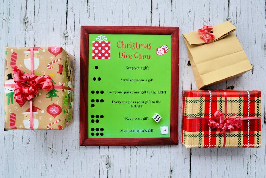 Consider cutting down on gifts this Christmas by doing fun alternatives, like this Christmas dice game.