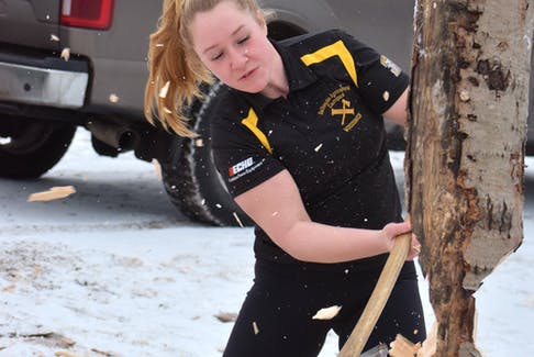 Marissa Albright lines up a practice shot with her ax as she and her team train for the upcoming Rick Russell Woodsmen Competition on Feb. 8. FRAM DINSHAW/TRURO NEWS