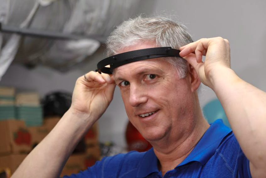Dalhousie University professor Clifton Johnston shows off a prototype of a headbands he and other engineers are 3D printing. They are making face shields to help bridge a possible shortage if the Nova Scotia Health Authority needs them.