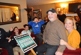 Darren O'Quinn, 50, of New Waterford, celebrates winning the District 11 seat in the Cape Breton Regional Municipality election race with wife Nancy, family and friends, shortly after the election results were released Saturday evening. Sharon Montgomery/Cape Breton Post