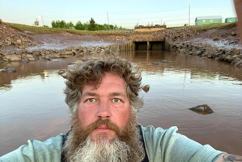 Darren Porter has been holding a vigil at gates of the Windsor causeway to raise awareness of the lack of fish passage. (CONTRIBUTED PHOTO)