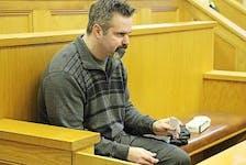 ['Telegram file photo<br />David Folker&nbsp; is shown in court in a 2013 photo.']