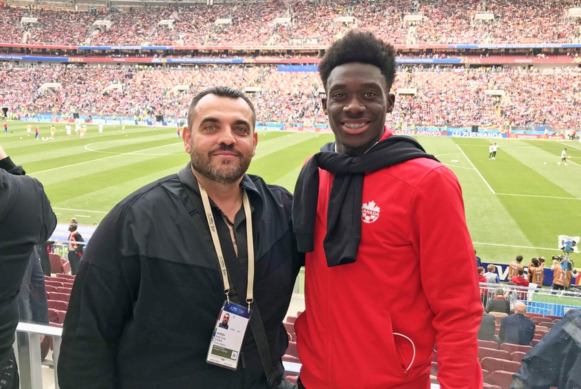 Alphonso Davies and his longtime family friend and manager, Nick Huoseh.