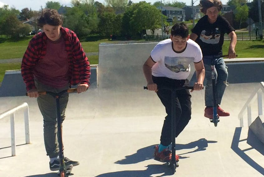 New Waterford resident Jackson Wiswell, right, catches some air during an afternoon with friends at the New Waterford skate park. He was joined by Keagan Ruelland, left, and Eric Routledge. CAPE BRETON POST