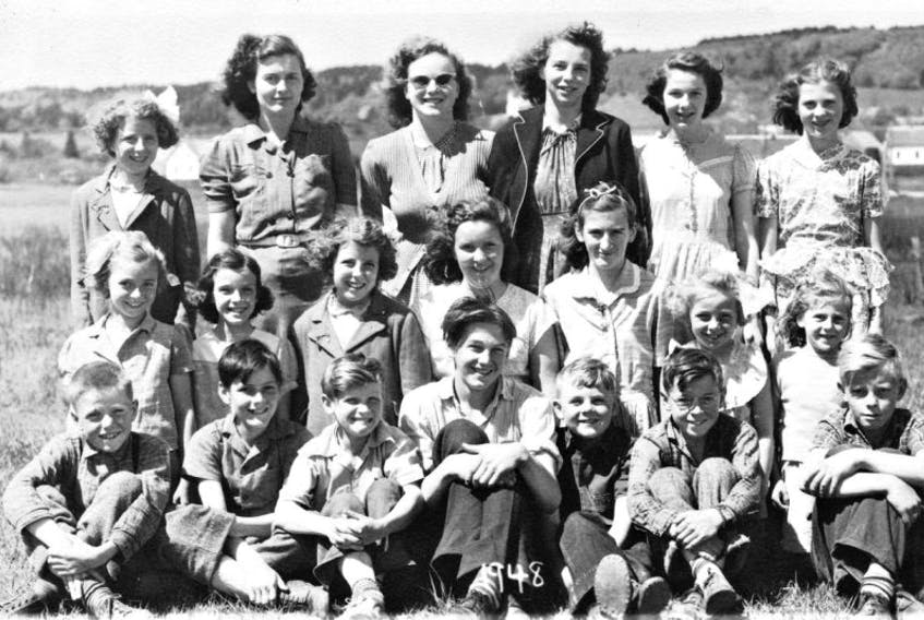 The date of this photo outside the Little River School is 1948, but names of the smiling students are unknown.