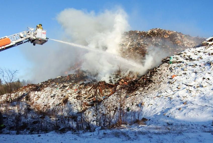 Firefighters attack a challenging debris fire on North River Road.