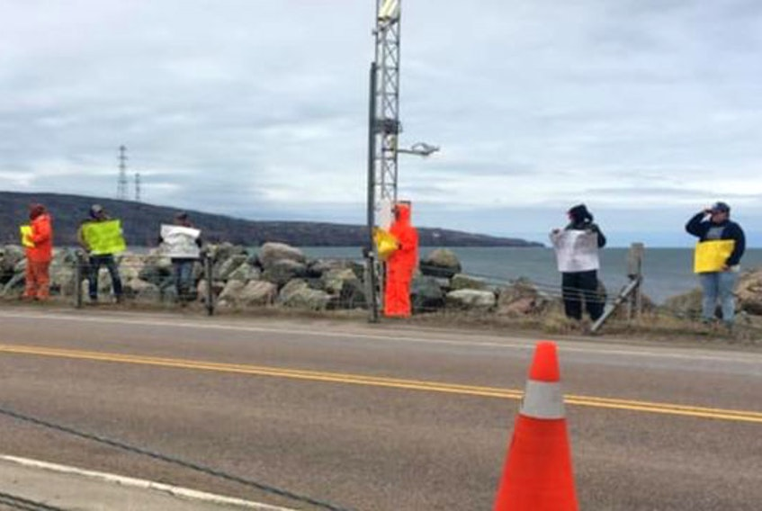 Some of the upwards of 75 fishermen from the Gulf region protested the two-week delay of the lobster season at the Canso Causeway on Monday. CONTRIBUTED/Cassie MacGillivray