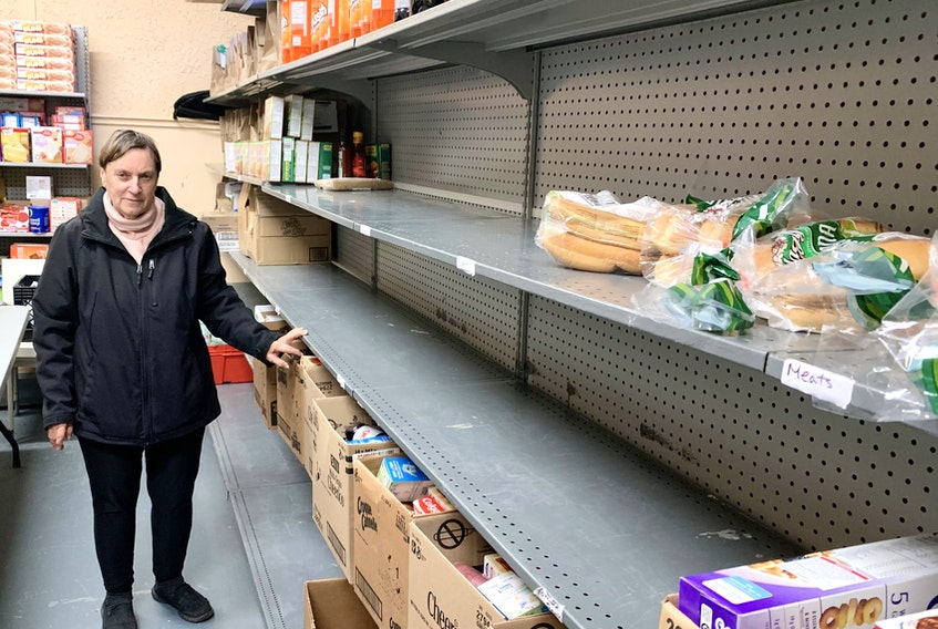 Madonna Galway, president of the Northeast Avalon Food Bank, said there are some empty shelves at the organization's building, in the basement of the Holy Trinity Parish Hall in Torbay. She hopes as Christmas gets near, more people will donate cash and gift certificates. — ROSIE MULLALEY/The Telegram