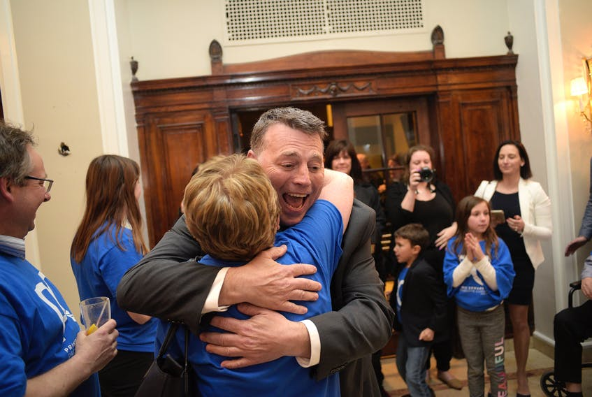 PC leader Dennis King hugs a supporter after arriving at a PC watch party at the Rodd Charlottetown on Tuesday night. King lead the PCs to a strong finished, with the party winning 12 seats. King is expected to lead a minority government.