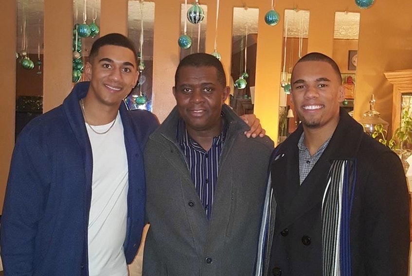 Derrick Brooks, middle,  and sons Jordan, left, and Justin have all played a major role in the Nova Scotia volleyball community. Contributed