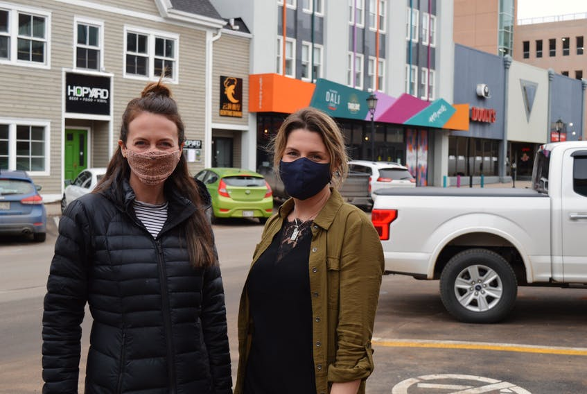 Shallyn Murray, left, an architect with Nine Yards Studio, and Heidi Zinn, executive director with Discover Charlottetown, are working on an idea to beautify the streetscape on roads such as Kent Street in Charlottetown.