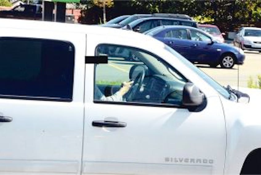 ['One of 29 drivers seen using cellphones on Elizabeth Avenue/New Cove Road Monday. — Photo by Keith Gosse/The Telegram']