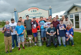 Noah Dobson poses with clients of Community Connections in Summerside. Dobson visited the non-profit organization that provides employment, residential and support services to adults with intellectual disabilities with the Memorial Cup and President Cup on Monday afternoon. Front row, from left: Evan Blood, Mitch MacNevin, Brad Cole, Kolton Doucette and Earl Shea. Back row: Ben Whyte, Robbie Halliday, Dobson, Cole Somers, Alex Blanchard, Shane Waite, Leo Kinch, Edison Murray, Jamie Gallant, Norman Pickering and Ryan Nicholson.