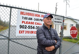 Claude Peach of Long Beach Road in Port Morien stands at the gates to the idle Kameron Collieries-owned Donkin Mine. Peach, who is a member of the Donkin Mine community liaison committee, said he personally hopes the coal mine reopens someday however he wants community concerns addressed first. Sharon Montgomery-Dupe • Cape Breton Post