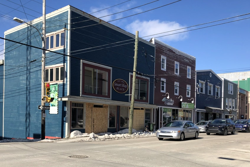 This corner of Charlotte Street might be misleading if people mistake the boarded up windows at the former Smart Shop location as an indication of a dying downtown Sydney. So far more businesses have opened in the area during the pandemic than closed. NICOLE SULLIVAN/CAPE BRETON POST