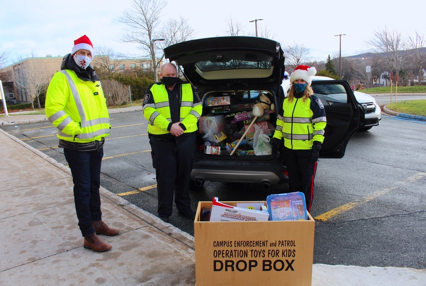 Chief risk officer, Greg McDougall, made sure the charity event followed protocols put in place because of the COVID-19 pandemic. From left: Greg McDougall, Robert Wall and Lynette Wells. — Andrew Waterman/The Telegram