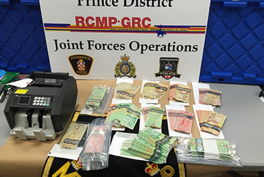 The RCMP say officers with the Prince District joint drug enforcement unit arrested two men on Feb. 19, 2021 in connection with an investigation that included the seizure of drugs, cash, contraband cigarettes and weapons.