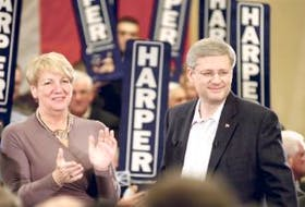 """['Prime Minister Stephen Harper and Premier Kathy Dunderdale stand together following Harper's speech at the Delta hotel Thursday evening. Harper said if the Conservatives are re-elected, they would provide this province with a loan guarantee """"or equivalent financial support"""" for the Lower Churchill project. — Photo by Keith Gosse/The Telegram']"""