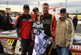 Dylan Blenkhorn (centre) lives and breathes everything on wheels. Pictured with Paul Blenkhorn (far left), Jace Stojak (second from left) and Sheldon Blenkhorn (right), the Pro Stock car driver is dedicating his automotive passion to helping people drive away in safe, reliable vehicles. - Photo Contributed.