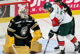 Cape Breton Eagles goalie Kevin Mandolese covers up a loose puck with Halifax Mooseheads forward Maxim Trépanier on the doorstep in this December 2019 Quebec Major Junior Hockey League file photo. The two Nova Scotia teams are expected to make moves when the league's trade period opens this morning. CAPE BRETON POST