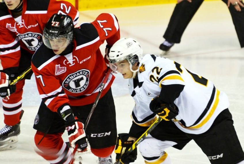 Jérome Varrier of the Remparts and Jacob Smith of the Screaming Eagles skate off the draw.