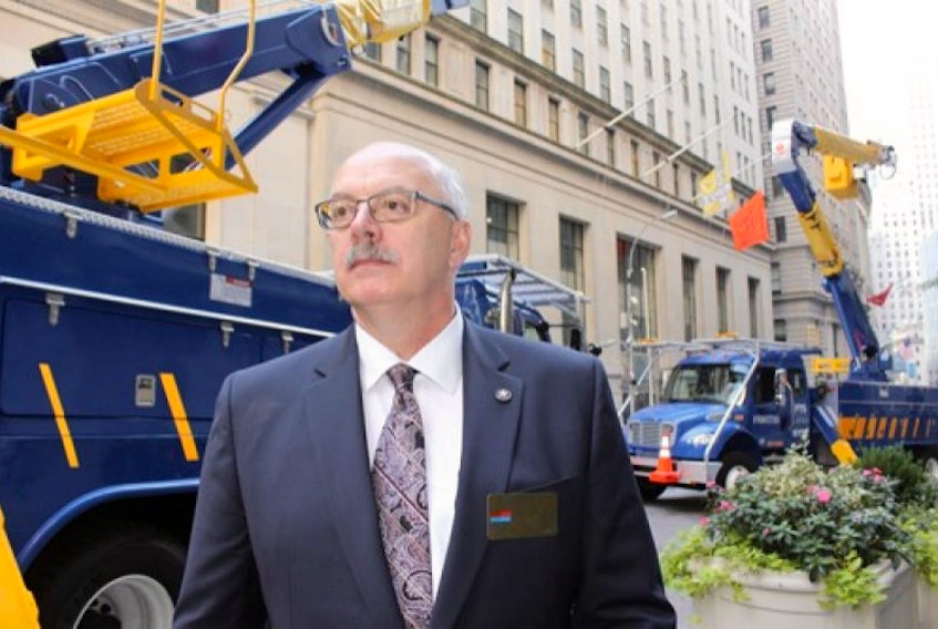 Earl Ludlow, Fortis' executive vice-president, Eastern Canadian & Caribbean Operations outside the New York Stock Exchange Tuesday morning as Fortis began trading on the exchange.