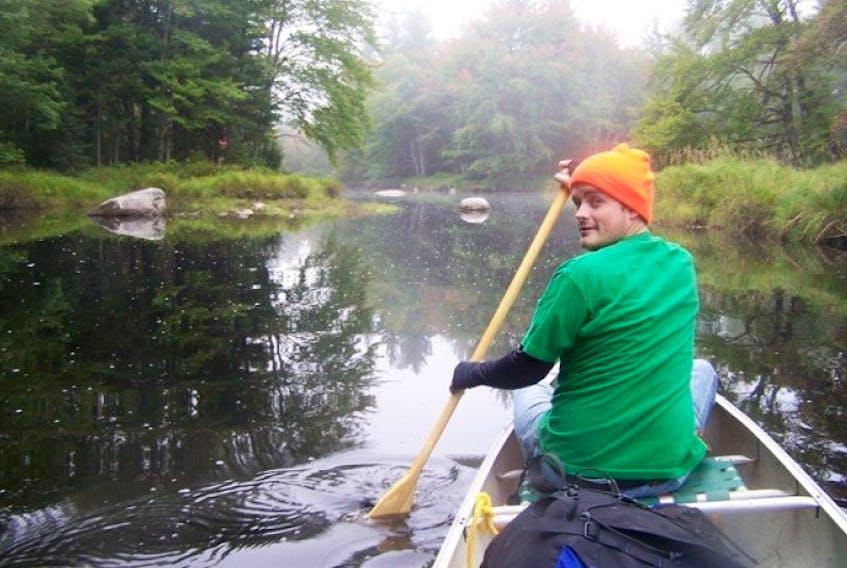 Jony and I paddled down Little River towards Kejimkujik Lake early on a cloudy fall morning. Jonathan Riley photo