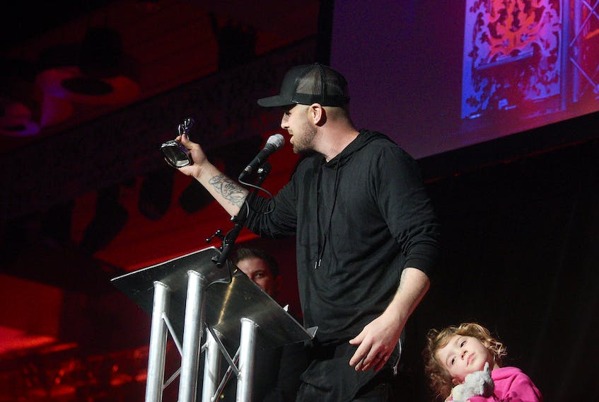 Classified, with his daughter on stage, accepts the ECMA for Album of the Year during the East Coast Music Awards Show in Charlottetown on Thursday, May 2, 2019.