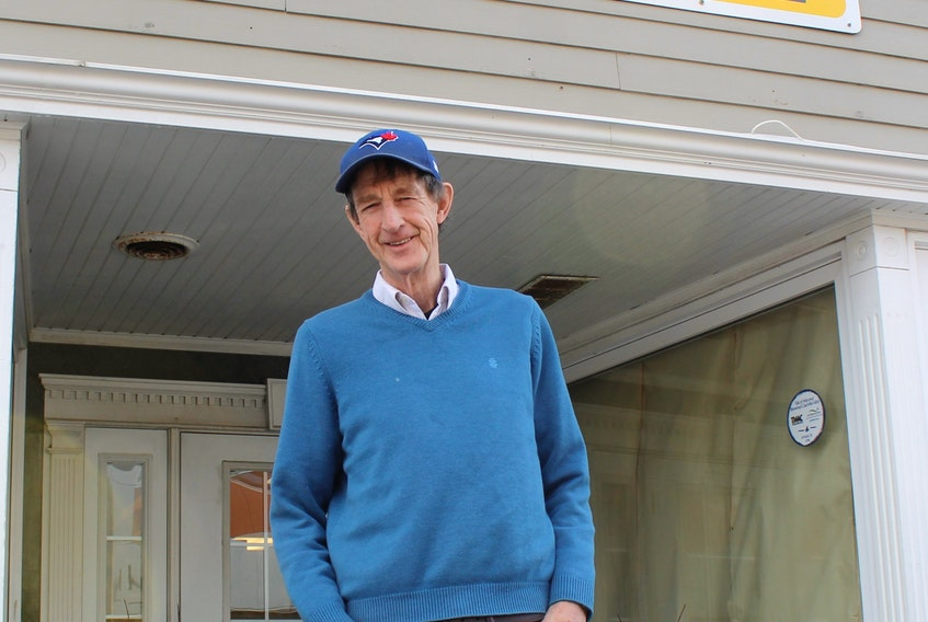 In this file photo, Ed Gillis, owner of Ed's Books and More, stands outside of his store location on Charlotte Street in Sydney. He's expected to reopen in the spring. GREG MCNEIL/CAPE BRETON POST