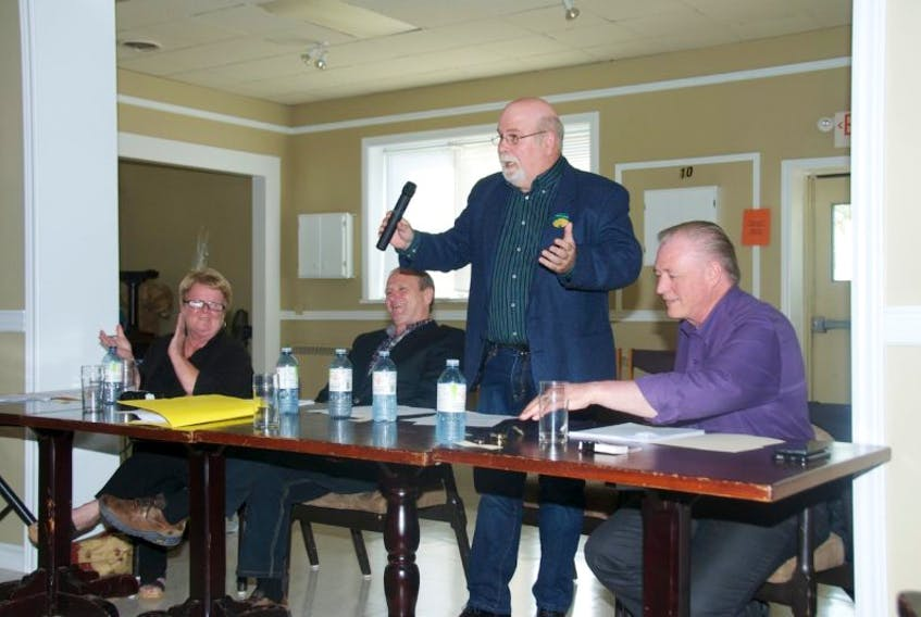 <p>Egmont Green Party candidate Nils Ling, standing, elicits a good-natured laugh from his opponents during a candidate's forum in Summerside on Monday. The gathering was hosted by the National Association of Federal Retirees and had all four candidates in attendance, including, from left, Conservative Gail Shea, Liberal Bobby Morrissey, second from left, Ling, and NDP Herb Dickieson.&nbsp;</p>