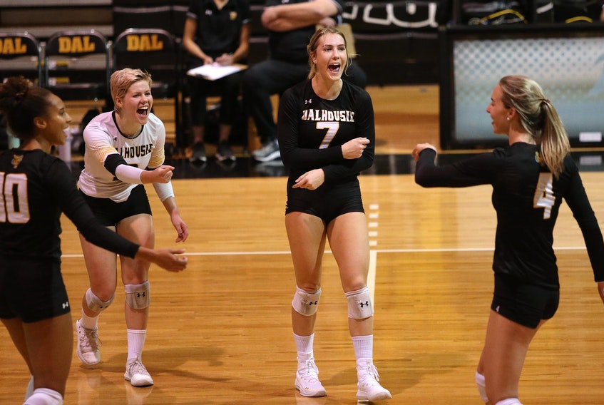 Dalhousie Tigers' Julie Moore (7), reacts to her kill with teammates Courtney Baker (10), Catherine Callaghan (white jersey) and Victoria Turcot  (4) during a match last season.  Moore, Callaghan and Turcot are a key members  of the Tigers' leadership group.  TIM KROCHAK/ The Chronicle Herald