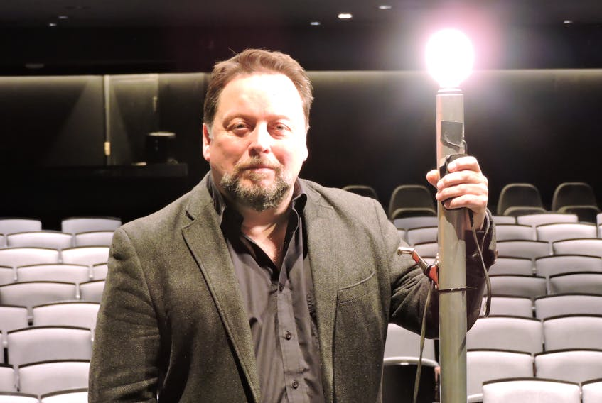 """Neptune Theatre artistic director Jeremy Webb, seen here with the Fountain Hall's """"ghost light"""", says the company is keeping its head above water for now, but more help will be needed from the public and the government to ensure the stage lights can come back on again when the COVID-19 pandemic subsides."""
