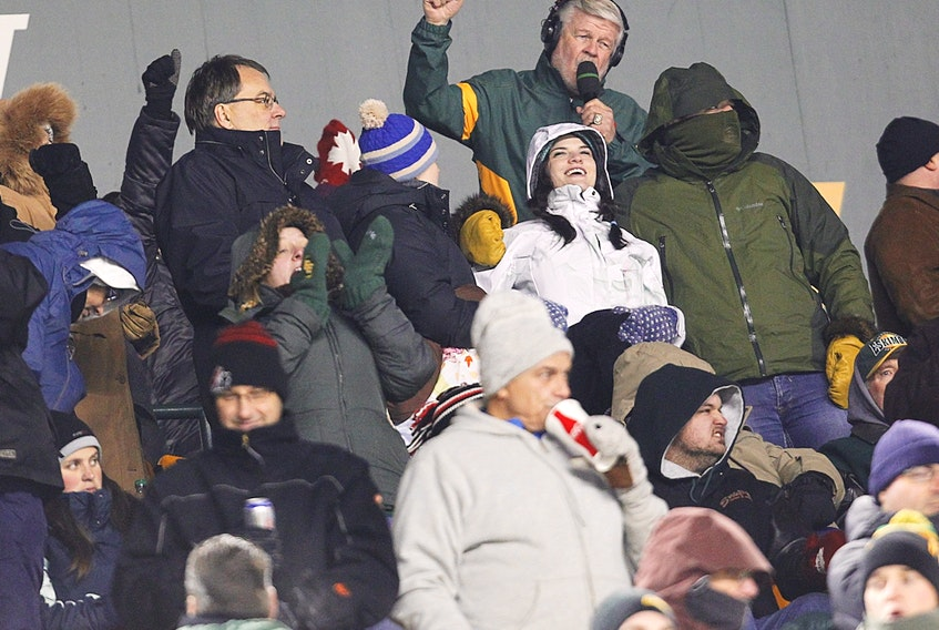 Bryan Hall leads the fans in the Edmonton Football Team's fight song at Commonwealth Stadium on Nov. 2, 2012.