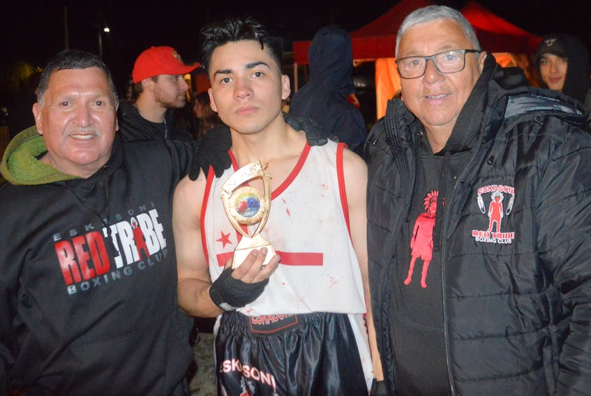 Eskasoni's Red Tribe boxing club postponed its Dec. 5 card because of the recent spike in COVID-19 cases. From left, Dale Bernard, Israel Regalado and Barry Bernard at the Lights Out boxing card in early October. OSCAR BAKER III • CAPE BRETON POST