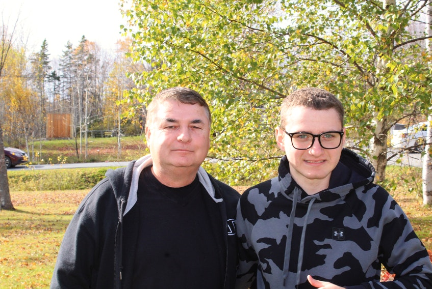 George (Tex) Marshall, left, is starting a hockey camp for kids on the autism spectrum because he says most programs are for kids younger than his son Kolton Marshall,16, right, and he wants programming for kids of all ages. Oscar Baker III/Cape Breton Post