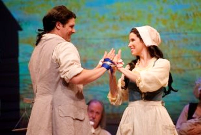 """[""""Adam Brazier and Chilina Kennedy perform as Gabriel and Evangeline in Ted Dykstra's musical, Evangeline, playing during the Charlottetown Festival at the Confederation Centre of the Arts.<br />""""]"""