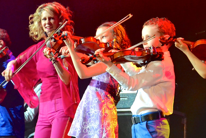Donnell Leahy and Natalie MacMaster look on proudly as three of their six children, Mary Frances, Michael and Clare, join them on stage at the 2016 East Coast Music Awards Gala in Sydney, the last time the awards took place in Cape Breton. CONTRIBUTED